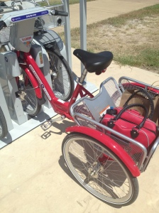 My GiveLoveCycle purse and our tourist shopping easily fit in the back basket, which has a 55lb capacity.