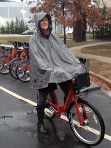 Here I am on a Capital Bikeshare bike in my Cleverhood. (Not the best photo since we were hurrying in the rain...)