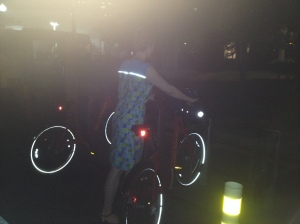 Docking the bike at home, with the reflective trim on the back of the dress doing its job.