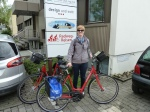 Bright red bikes, matching blue panniers = Radweg-Reisen