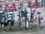 Love the pink bike! and the bike rack design that keeps handlebars a bit less crammed together.