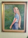 Painting in my parents' house of me, back when I had long hair. My grandmother painted it. My mom and I get our artistic talent from her.