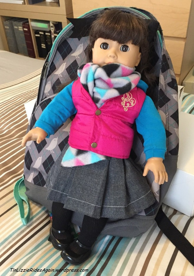 Samantha, dressed in borrowed outwear
