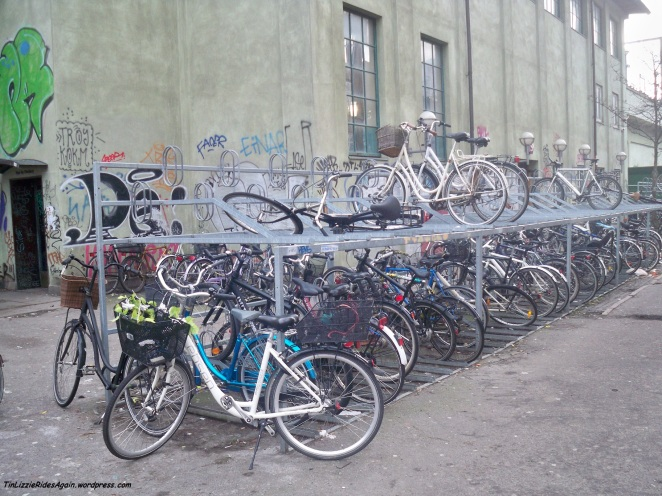 "That bike on the top row of this Copenhagen bike rack is what I'd call ""wrongly parked."""