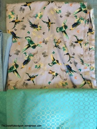 Lovely hummingbirds and teal reflective fabric