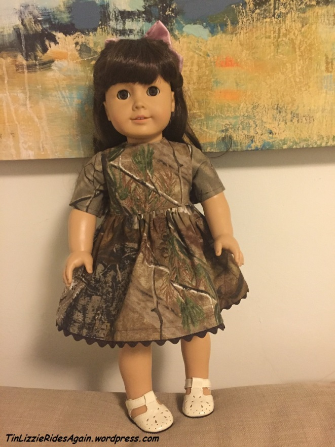 Although camo isn't Samantha's thing, the dress looks good on her!