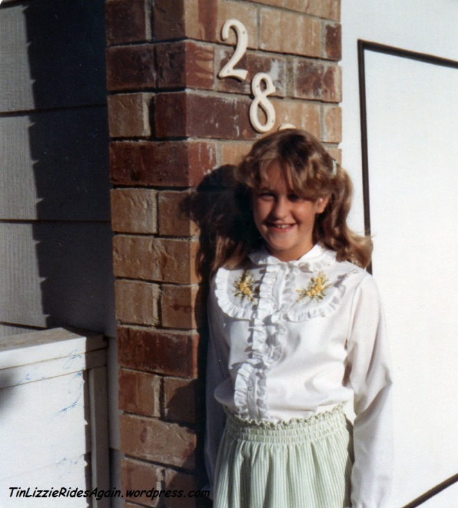Fifth Grade - yes, I am wearing a blouse that my mother embroidered. I forget the technique but I know I loved it (and still do). I assume that I slept on foam curlers to get my hair that curly.