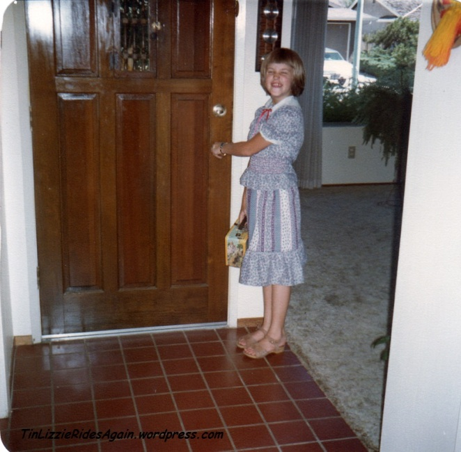 Third Grade - another floral print dress! No socks this day, bet it was hot. Same lunch box too. And guess I had my hair cut off in between years.