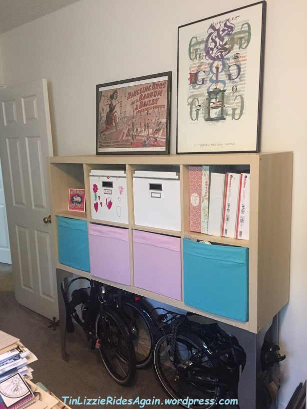 Folding bikes below, sewing stuff in the cubbies, art work will eventually be hung on the wall.