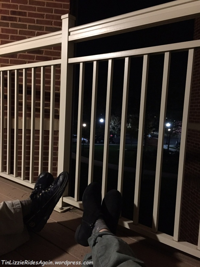 Enjoying the balcony from our very low camp chairs. Fun lights and taller chairs are on the list